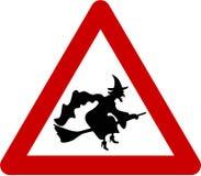 Sinal de aviso com bruxa ilustração stock
