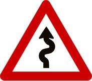 Sinal de aviso com estrada de enrolamento ilustração stock