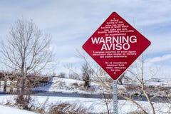 Sinal de aviso da poluição de água Foto de Stock Royalty Free