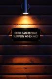 Sinal de aviso do Lit na madeira molhada Imagem de Stock Royalty Free
