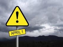 Sinal de aviso do perigo - 1º de abril dia do ` dos tolos Forma triangular Fotografia de Stock Royalty Free
