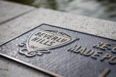 Sinal de Beverly Hills feito fora do bronze fotografia de stock