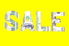 Sinal de dólar da venda em um fundo amarelo Fotografia de Stock