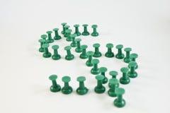 Sinal de dólar verde feito dos pinos Fotos de Stock Royalty Free