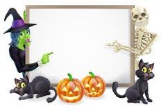 Sinal de Dia das Bruxas com esqueleto e bruxa Foto de Stock