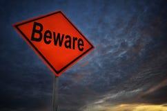 Sinal de estrada alaranjado da tempestade Beware imagens de stock royalty free