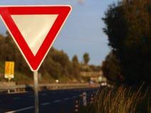 Sinal de estrada da prioridade foto de stock