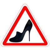 Sinal de estrada de advertência com a sapata do `s da mulher Fotografia de Stock
