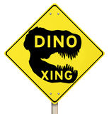 Sinal de estrada de Dino Xing Dinosaur Crossing Yellow Warning Fotografia de Stock Royalty Free