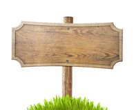 Sinal de estrada de madeira velho com a grama isolada no branco Fotografia de Stock