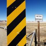 Sinal de estrada do cuidado. Foto de Stock