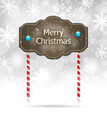 Sinal de madeira coberto de neve, fundo do Feliz Natal ilustração royalty free