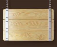Sinal de madeira com o ferro que pendura em correntes Imagens de Stock