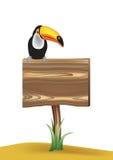 Sinal de madeira em branco com Toucan Imagens de Stock Royalty Free