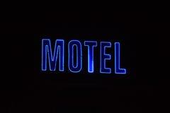 Sinal de néon com o motel da palavra Imagem de Stock