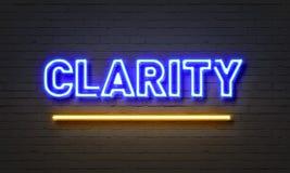 Sinal de néon da claridade no fundo da parede de tijolo imagens de stock