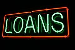 Sinal de néon vermelho e verde do empréstimo Fotografia de Stock