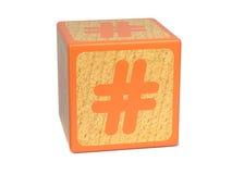 Sinal de número - bloco do alfabeto das crianças. Fotos de Stock