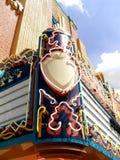 Sinal de néon do famoso da casa de filme Fotografia de Stock Royalty Free