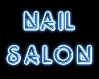 Sinal de néon do SALÃO DE BELEZA azul do PREGO Foto de Stock Royalty Free