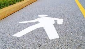 Sinal de rua de passeio do símbolo do homem  Fotografia de Stock Royalty Free