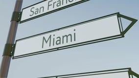 Sinal de sentido de Miami no letreiro da estrada com subtítulos americanos das cidades Rendição 3d conceptual Fotografia de Stock Royalty Free