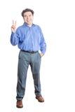 Sinal de Showing Peace Hand do homem de negócios na câmera Fotos de Stock Royalty Free