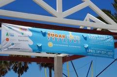 Sinal de Sugar Sand Festival do cais 60 Imagem de Stock