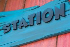 Sinal de uma estação Fotos de Stock Royalty Free
