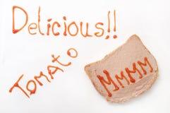 Sinal delicioso com ketchup e mmmm no pão com pasta Imagens de Stock Royalty Free