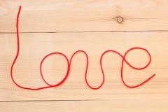 Sinal do amor no fundo de madeira Foto de Stock Royalty Free