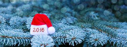 Sinal do ano novo 2016 com chapéu de Santa Claus Fotos de Stock