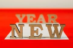 Sinal do ano novo das letras de madeira Fotos de Stock
