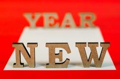 Sinal do ano novo das letras de madeira Foto de Stock Royalty Free