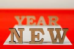 Sinal do ano novo das letras de madeira Fotografia de Stock Royalty Free