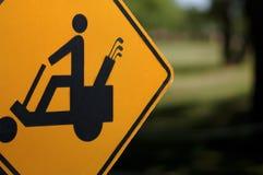 Sinal do cuidado do carro de golfe Imagens de Stock