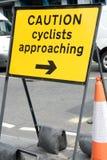 Sinal do cuidado para ciclistas Fotos de Stock