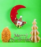 Sinal do Feliz Natal com velas do xmas Imagens de Stock Royalty Free