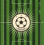 Sinal do futebol do vintage no campo Fotos de Stock Royalty Free