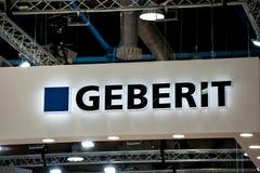 Sinal do logotipo da empresa de Geberit na parede fotografia de stock royalty free
