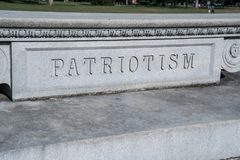 Sinal do patriotismo cinzelado na pedra Fotos de Stock Royalty Free