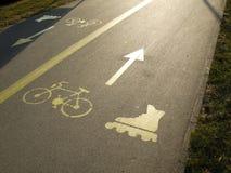 Sinal do rolo e da bicicleta Fotografia de Stock Royalty Free