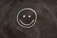 Sinal do sorriso no quadro-negro imagens de stock