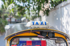 Sinal do táxi, Tailândia Fotografia de Stock