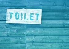Sinal do texto do toalete Fotografia de Stock Royalty Free