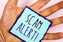 Sinal do texto que mostra a Scam a chamada inspirador alerta Aviso conceptual da segurança das fotos para evitar ataques da fraud fotografia de stock