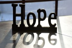 Sinal e reflexão da esperança fotos de stock