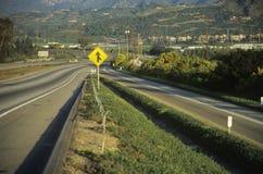 Sinal em uma estrada Imagem de Stock Royalty Free