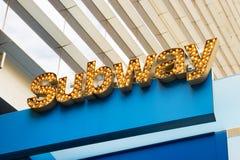 Sinal iluminado do metro, NYC Fotos de Stock Royalty Free
