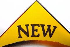 Sinal NOVO no empacotamento Imagem de Stock Royalty Free